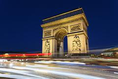 Stock Photo of arc de triomphe and car lights
