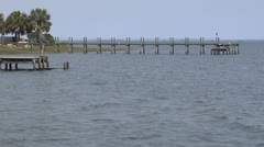 FLORIDA FISHERMAN FISHING FROM DOCK ON THE GULF OF MEXICO Stock Footage