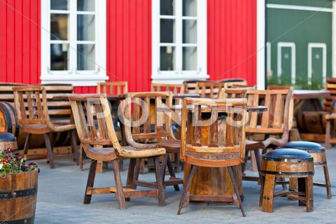 Stock photo of outdoor summer cafe tables in viking style at iceland town