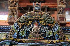 Door portal on hindu temple with ganesha in Kathmandu Stock Photos