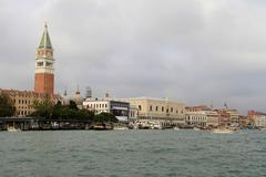Travel Venice: view of St. Marks square from lagoon Stock Photos