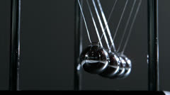 Newtons cradle in motion - stock footage