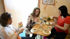 Pregnant women drink tea with cake Stock Footage