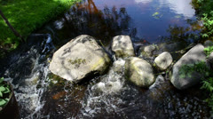 River water flow with stones underwater and reflections Stock Footage