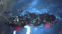 Strawberries falling into water and floating Stock Footage