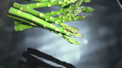 Asparagus stalks falling into water Stock Footage