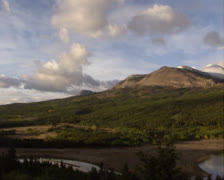 Pan valley Two Medicine lake, September sunlight - wide shot Stock Footage