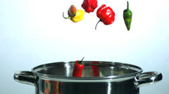 Various chilis falling in a pot Stock Footage