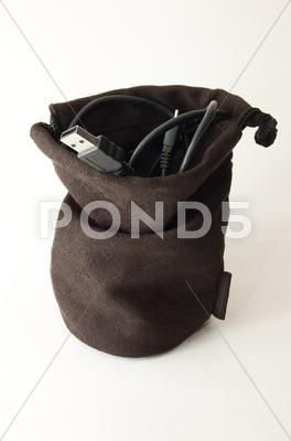 Stock photo of usb cable in brown bag