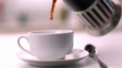 Coffee being poured into cup Stock Footage