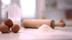 Flour sprinking on kitchen counter with baking tools Stock Footage