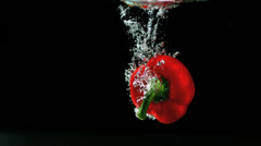Stock Video Footage of Red pepper falling in water and floating