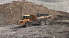 Dumptruck loading of dirt - stock footage
