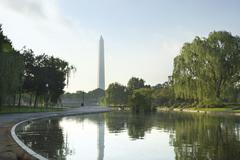 Morning shot of the washington monument reflected in a pond Stock Photos