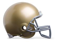 Gold football helmet in profile view isolated on a white background Stock Photos
