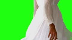 Girl in white dress twirling on green screen close up Stock Footage