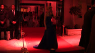 Socialite Hofit Golan on the phone outside Chopard Cannes Film Festival Party Stock Footage