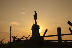 silhouette of civil war monument at bloody lane, antietam battlefield - stock photo