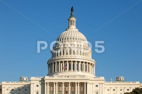 Stock photo of u.s. capitol dome rear face on sunny winter day blue sky