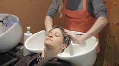 Stock Video Footage of hairstylist rinse the hair - hairdresser - hairstylist