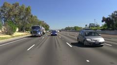 Driving freeway traffic, tanker, low rear Stock Footage
