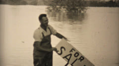 Man Holding For Sale Sign In Flooded Backyard-1948 Vintage 8mm Stock Footage