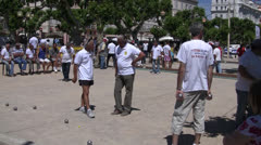 French Men Gathered around playing Boules Stock Footage