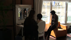 Women sit by window for Hairdressing & makeup before Cannes Film Festival - stock footage