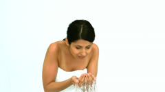 Woman washing her face Stock Footage