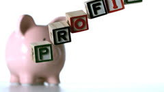 Profit spelled out in block letters dropping down Stock Footage