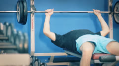 Young man in gym doing chest exercise Stock Footage