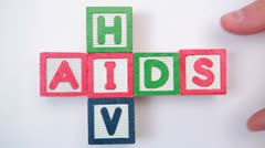 HIV and aids spelled out in blocks Stock Footage