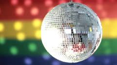 Disco ball spinning against rainbow flag - stock footage