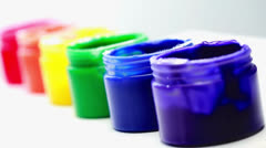 Rainbow paint pots in a row for gay pride Stock Footage