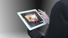Businesswoman using tablet to view montage of lifestyle clips Stock Footage