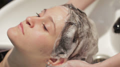 Hairstylist lathers the hair Stock Footage