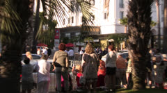 Crowds gathered at the street in Cannes for the Film Festival - stock footage