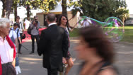 Lizzie Cundy walks through park in Cannes Stock Footage