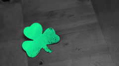 Stock Video Footage of Hand putting down empty pint beside large green shamrock