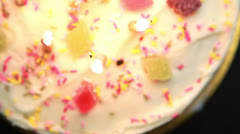 Revolving birthday cake with candles blown out Stock Footage