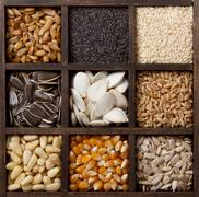 assorted edible seeds arranged in a box - stock photo