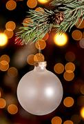 A christmas ornament hanging from a pine branch Stock Photos