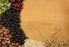 Piles of beans rice peas and lentils Stock Photos