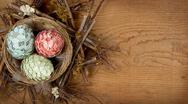 Stock Photo of decorative easter eggs made of paper in nest