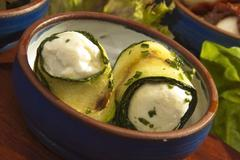 Courgette filled by the fetta cheese Stock Photos