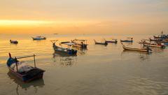 fisherman boat on sunset - stock photo