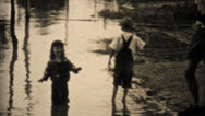 Kids Explore Their Flooded Neighborhood In Dallas Texas-1948 Vintage 8mm Stock Footage