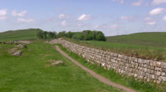 Hadrian's Wall: a wide sweeping shot taken from Peel Crags Stock Footage