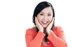 Attractive asian woman looking surprised Stock Photos