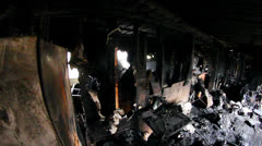 Pan of inside of house that had recently been destroyed by fire Stock Footage